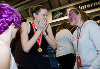 11 MAR 2009 - SHEFFIELD,GBR - Loughborough University's Jo Harten (centre) celebrates the teams victory over the University of Bath in the Netball Championship Final 2009 BUCS Championships with supporters Jade Clarke and Alex Kirk. (PHOTO (C) NIGEL FARROW)