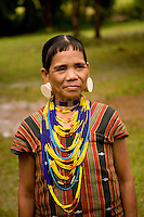 Decorated woman from Laos-Vietnam border at cultural center on Bolaven Plateau,Laos