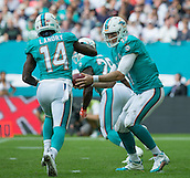 04.10.2015. Wembley Stadium, London, England. NFL International Series. Miami Dolphins versus New York Jets. Miami Dolphins Quarterback Ryan Tannehill passes the ball to Miami Dolphins Wide Receiver Jarvis Landry during the first quarter.