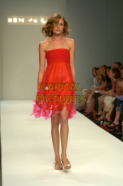 MODEL.Ben De Lisi Spring / Summer 2008 Fashion Show during Day One of London Fashion Week, BFC Tent, London, England, September 15th 2007. .LFW modelling catwalk runway full length red strapless dress pink discs.CAP/CAN.©Can Nguyen/Capital Pictures