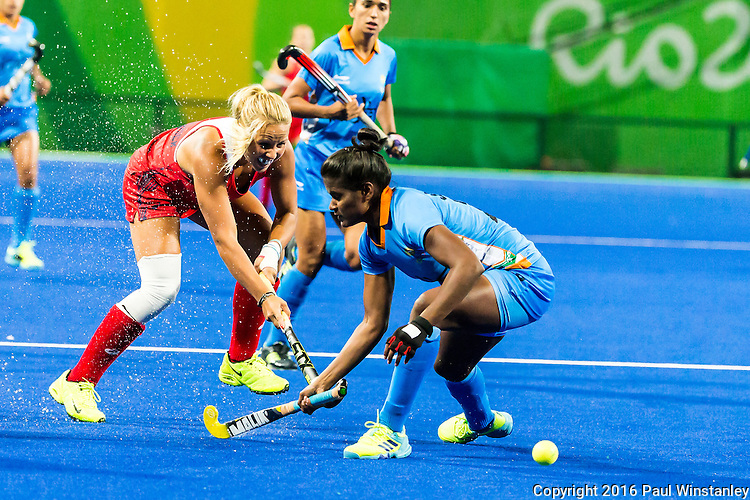 Kelsey Kolojejchick #7 of United States passes the ball during USA vs India in a women's Pool B game at the Rio 2016 Olympics at the Olympic Hockey Centre in Rio de Janeiro, Brazil.