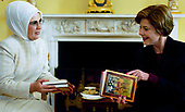 United States first lady Laura Bush accepts books ofpoetry byTurkish poet Rumi presented byEmine Erdogan, wife of the Prime Minister of Turkey, during a coffee at the White House Thursday, January 29, 2004.<br /> Mandatory Credit: Susan Sterner / White House via CNP