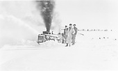 Rotary snowplow working deep snow.  Three workmen posing for photo.<br /> D&amp;RGW  Cumbres Pass ?, CO