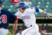 Round Rock Express outfielder Jim Adduci (24) sprints towards home plate against the Oklahoma City RedHawks during the Pacific Coast League baseball game on August 25, 2013 at the Dell Diamond in Round Rock, Texas. Round Rock defeated Oklahoma City 9-2. (Andrew Woolley/Four Seam Images)