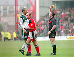 Stan Collymore of Liverpool pinches Steve Stone of Nottingham Forest for which he only received a yellow card - Premier League - Nottingham Forest v Liverpool - City Ground - Nottingham - England - 23rd March 1996 - Picture Simon Bellis/Sportimage