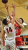 Sean Braithwaite #21 of Center Moriches, right, makes an aggressive move to the hoop as Gregory Forstner #14 of Babylon challenges his shot during a Suffolk County League VII varsity boys basketball game at Babylon High School on Friday, Jan. 26, 2018. Center Moriches won by a score of 84-80.
