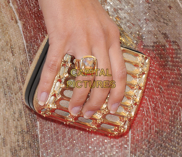 Camila Alves' hand .at TV Land's 2011 AFI Lifetime AChievement Award Honoring Morgan Freeman held at Sony Picture Studios in Culver City, California, USA, .June 9th 2011..detail ring  gold clutch bag                                                                .CAP/RKE/DVS.©DVS/RockinExposures/Capital Pictures.