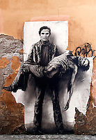 Il murale di Pasolini a Campo de' Fiori<br /> Roma 24-05-2015 Piazza Campo de' Fiori. Un altro murale di Pier Paolo Pasolini e' apparso nel vicolo adiacente la piazza.<br /> A wall painting of the famous italian writer and film director, Pier Paolo Pasolini, appeared in various places in Rome, by an unknown artist. The painting shows Pasolini carrying himself, dead, in his arms. The film director was killed on 1975, probably because he was gay. This night, the first of this paintings was ripped<br /> Photo Samantha Zucchi Insidefoto