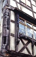 Riquewihr: Fachwerk ( half-timbered) facade. Corner wooden sculpture.