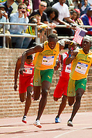 Usain Bolt takes the handoff from Marvin Anderson in the Men's Olympic Development 4x100 Relay at the Penn Relays in Philadelphia. Bolt anchored the Jamaica Gold team to victory in 37.90 seconds by running a split of 8.79.