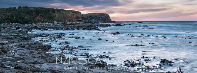 Sunrise on Curio Bay with remnants of fosilized forest, Catlins, Southland, New Zealand, NZ