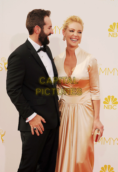 LOS ANGELES, CA- AUGUST 25: Actress Katherine Heigl (R) and husband/singer Josh Kelley arrive at the 66th Annual Primetime Emmy Awards at Nokia Theatre L.A. Live on August 25, 2014 in Los Angeles, California.<br /> CAP/ROT/TM<br /> &copy;Tony Michaels/Roth Stock/Capital Pictures