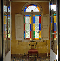Multi-coloured glass panes frame this fanlight window