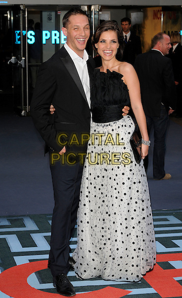 TOM HARDY & CHARLOTTE RILEY .At the World Premiere of 'Inception' at the Odeon Leicester Square cinema, Leicester Square, London, England, .UK, July 8th 2010..Arrivals full length strapless black long maxi dress grey gray white polka dot print  suit couple arm around smiling funny laughing .CAP/CAN.©Can Nguyen/Capital Pictures.