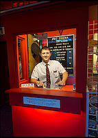 BNPS.co.uk (01202 558833)<br /> Pic: PhilYeomans/BNPS<br /> <br /> Tickets please...proud Andy mans the kiosk.<br /> <br /> Field of Dreams....<br /> <br /> Film buff Andy Jones has built an ABC cinema in his back garden as a lasting tribute to the now defunct movie company.<br /> <br /> Andy, 38, has taken four and a half years and spent &pound;70,000 of his life savings building the 34-seat cinema from scratch.<br /> <br /> The father-of-two's movie house mirrors cinemas of the 1930s with big red curtains, red seats and a parquet floor in the projection room. <br /> <br /> The brick building, which is adorned with an ABC sign, is 40ft tall, 22ft wide and 20ft high and takes up half of the garden of his three bed semi-detached house.<br /> <br /> The theatre, which has a 17ft by 7ft screen, has its own projection room, black and white old-style toilets and a foyer with a concessions stand that offers popcorn and sweets.