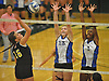 Long Beach teammates No. 13 Natalie Swegler, center, and No. 2 Shayla Nieves defend against a spike attempt by Wantagh No. 15 Jillian Graham during the Nassau County varsity girls' volleyball Class A final at SUNY Old Westbury on Wednesday, Nov. 11, 2015. Wantagh won 3-0.<br /> <br /> James Escher