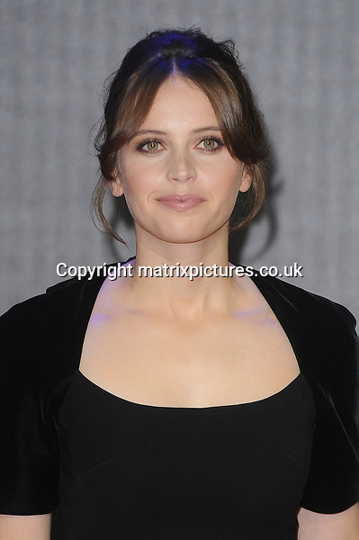 NON EXCLUSIVE PICTURE: PAUL TREADWAY / MATRIXPICTURES.CO.UK<br /> PLEASE CREDIT ALL USES<br /> <br /> WORLD RIGHTS<br /> <br /> English actress Felicity Jones attending the European Premiere of Star Wars: The Force Awakens in Leicester Square, London.<br /> <br /> DECEMBER 16th 2015<br /> <br /> REF: PTY 153700