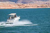 Motor boat cruising on lake Powell