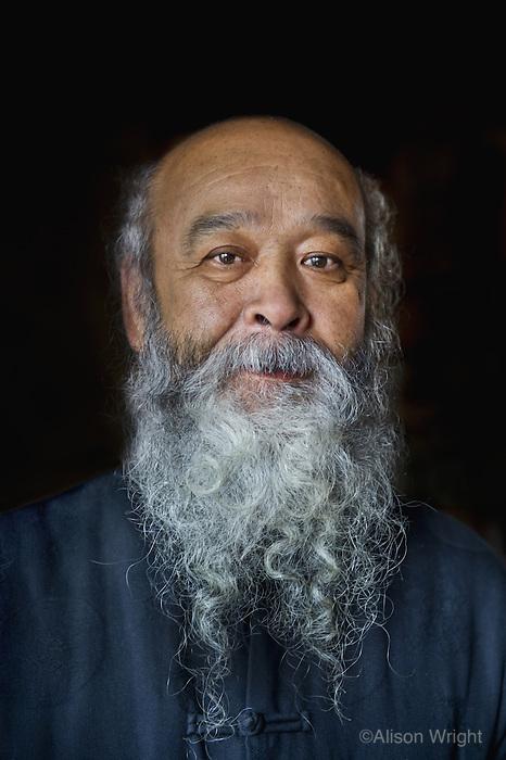 China, Yunnan, Lijiang. Mr. Lee at his vegetarian restaurant, 2010