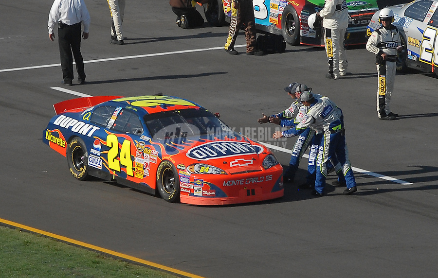Apr 29, 2007; Talladega, AL, USA; Nascar Nextel Cup Series driver Jeff Gordon (24) is congratulated by crewmembers after winning the Aarons 499 at Talladega Superspeedway. Mandatory Credit: Mark J. Rebilas
