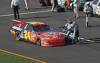 Apr 29, 2007; Talladega, AL, USA; Nascar Nextel Cup Series driver Jeff Gordon (24) is congratulated by crewmembers after winning the Aarons 499 at Talladega Superspeedway. Mandatory Credit: Mark J. Rebilas