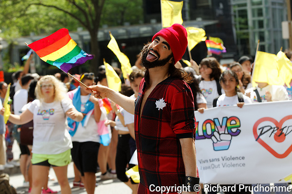 Montreal, Canada 20/08/2017. A young man takes part  in the 2017 Montreal LGTQ Parade. Richard Prudhomme