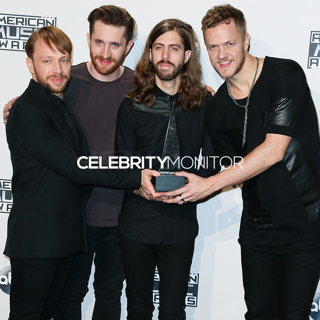 LOS ANGELES, CA, USA - NOVEMBER 23: Ben McKee, Daniel Platzman, Daniel Wayne Sermon, Dan Reynolds, Imagine Dragons pose in the press room at the 2014 American Music Awards held at Nokia Theatre L.A. Live on November 23, 2014 in Los Angeles, California, United States. (Photo by Xavier Collin/Celebrity Monitor)