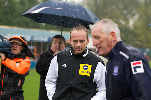 04.11.12 Braintree, England. The FA Cup First Round game between Braintree Town and Tranmere Rovers from the Amlin Stadium. Match is called of due to a water logged pitch. Managers and officials discuss the position