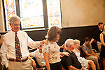 The Sunday service led by Reverend Matthew Nelson at Inman Park United Methodist Church in Atlanta, Georgia August 5, 2012...The congregation lays hands on each other as they pray with the children and teachers the day before the first day of school.
