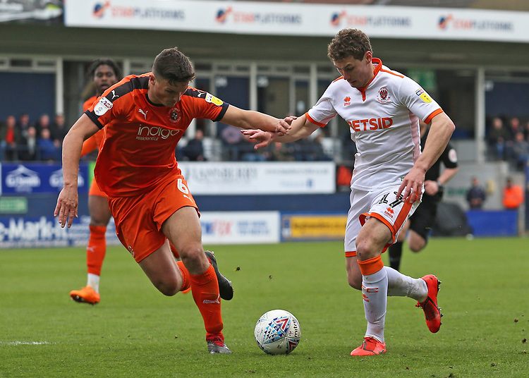 Luton Town's Matty Pearson holds off the challenge from Blackpool's Matty Virtue<br /> <br /> Photographer David Shipman/CameraSport<br /> <br /> The EFL Sky Bet League One - Luton Town v Blackpool - Saturday 6th April 2019 - Kenilworth Road - Luton<br /> <br /> World Copyright © 2019 CameraSport. All rights reserved. 43 Linden Ave. Countesthorpe. Leicester. England. LE8 5PG - Tel: +44 (0) 116 277 4147 - admin@camerasport.com - www.camerasport.com