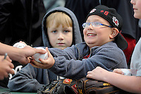 A young fan gets an autograph from members of the South Carolina Gamecocks before a game against the Furman Paladins on Tuesday, April 8, 2014, at Fluor Field at the West End in Greenville, South Carolina. (Tom Priddy/Four Seam Images)