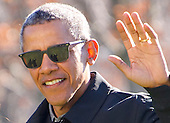 The shadows of United States President Barack Obama and Malia Obama are reflected in The President's sunglasses as he waves to the assembled press as the first family returns to the South Lawn of the White House in Washington, DC following their two week Hawaiian vacation on Sunday, January 3, 2016. <br /> Credit: Ron Sachs / Pool via CNP