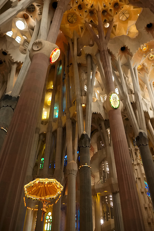 "56 ""nature-like"" columns shoot upward in a dramatic display inside Gaudi's Sagrada Familia, with Christ hanging on the cross suspended in space."
