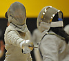 Stephanie Miller of Commack, left, duels against Gabby Reyes of Brentwood in sabre during a girls fencing match at Commack High School on Friday, Dec. 2, 2016. Miller won the bout 5-2.