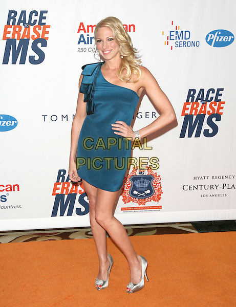 DEBORAH GIBSON.The 18th Annual Race To Erase MS Gala held at The Hyatt Regency Century Plaza Hotel in Century City, California, USA. .April 29th, 2011.full length blue one shoulder dress silver shoes hand on hip debbie .CAP/RKE/DVS.©DVS/RockinExposures/Capital Pictures.