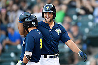 Designated hitter Tim Tebow (15) of the Columbia Fireflies playfully grabs Michael Paez after Tebow scored a run in a game against the Lexington Legends on Thursday, June 8, 2017, at Spirit Communications Park in Columbia, South Carolina. Columbia won, 8-0. (Tom Priddy/Four Seam Images)