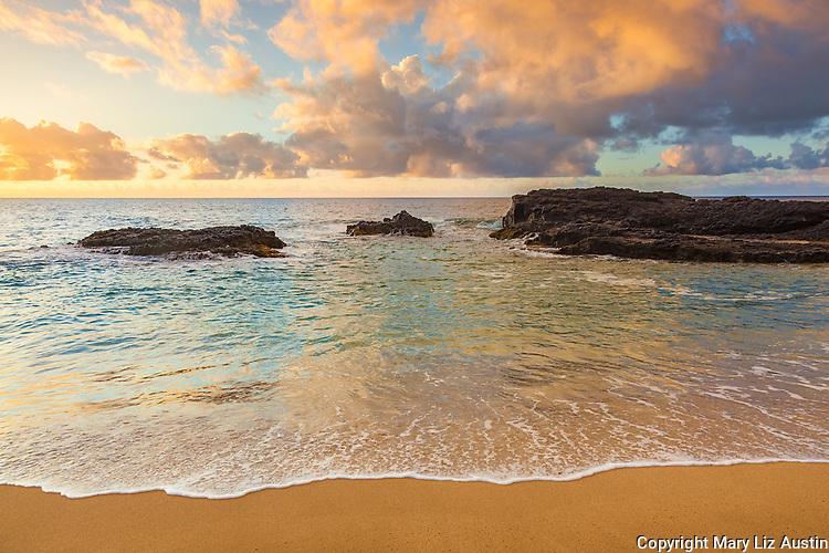 Kauai, H:I Evening light on Lumaha'i Beach with colors of the sky reflecting on surf and beach