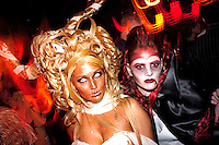 PHILADELPHIA - NOVEMBER 12: Gina Luca (L), 30, and Nikki Carter, 21, of Blackwood, New Jersey show off their designs and hairstyles during Hairball 9 at Shampoo Niteclub November 12, 2005 in Philadelphia, Pennsylvania. Hairball, which is the East Coast's largest annual hair design competition featured models sporting outrageous themed hair designs and parade the catwalk. All proceeds from the event will benefit cancer and HIV/AIDS research and treatment at the world-renowned City of Hope National Medical Center and Beckman Research Institute. (Photo by William Thomas Cain/Cain Images)
