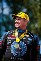 Jun 9, 2019; Topeka, KS, USA; NHRA funny car driver Robert Hight celebrates after winning the Heartland Nationals at Heartland Motorsports Park. Mandatory Credit: Mark J. Rebilas-USA TODAY Sports