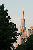 American Cathedral of the Holy Trinity in Paris.  Steeple shot through trees in early morning light.  Shot from Champs Elysees.  July 2008