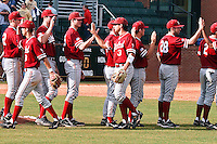 NASHVILLE, TENNESSEE-Feb. 27, 2011:  The Stanford team gives each other a congratulatory handshake following the game at Vanderbilt.  Stanford defeated Vanderbilt 5-2.