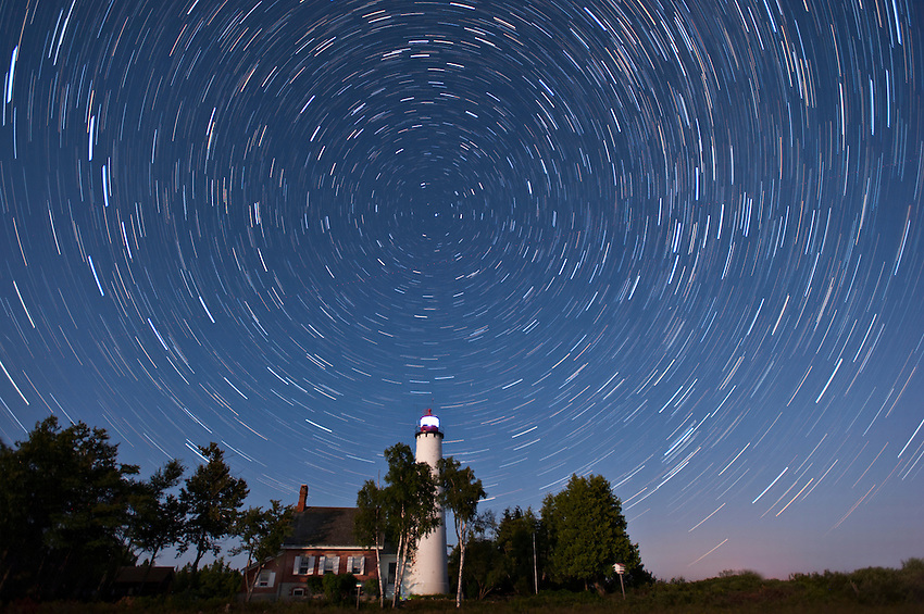 A stacked image of star trails over St. Helena Island Lighthouse on Lake Michigan near Mackinaw City Michigan. 30-second exposures over about 40 minutes.