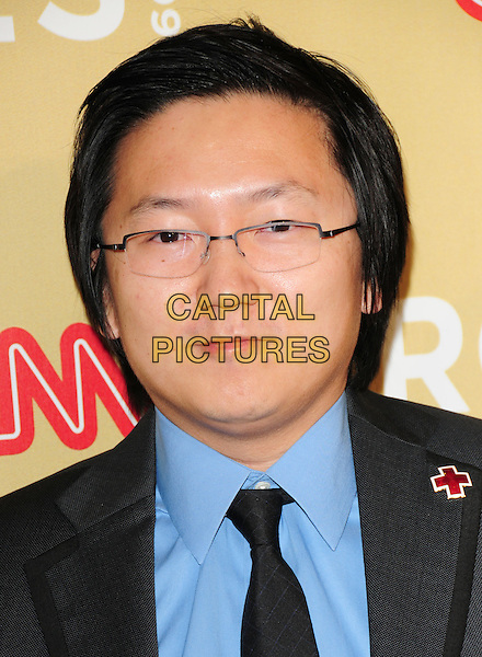MASI OKA & GUEST .at The 3rd Annual CNN Heroes: An All-Star Tribute held at The Kodak Theatre in Hollywood, California, USA,  November 21st 2009                                                                   .portrait headshot glasses red cross pin brooch grey gray jacket black blue shirt tie .CAP/RKE/DVS.©DVS/RockinExposures/Capital Pictures
