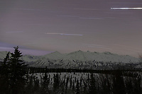 winter landscape of night sky Star trails overh Chugach  mountains.  Southcentral, Alaska in the Glacier View/Eureka area