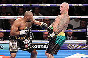 24th March 2018, O2 Arena, London, England; Matchroom Boxing, WBC Silver Heavyweight Title, Dillian Whyte versus Lucas Browne; Dillian Whyte sends Lucas Browne backwards after a barrage of shots early on in the fight