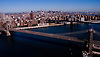 Aerial views Brooklyn and Williamsburg Bridge over east river.