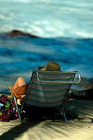 woman relaxing at Magic sands beach, Kailua Kona The Big Island of Hawaii
