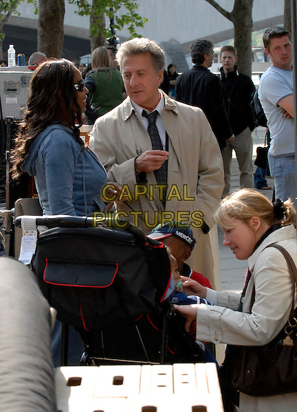 """DUSTIN HOFFMAN & EMMA THOMPSON.Chatting with fans on the set of """"Last Chance Harvey"""" refilming scenes near The Royal Festival Hall, Embankment, London, England..May 21st, 2008.film movie half length beige trench coat mac .CAP/IA.©Ian Allis/Capital Pictures."""