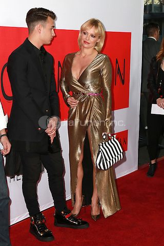 Brandon Thomas Lee, Pamela Anderson at the premiere of Open Road Films' 'The Gunman' at Regal Cinemas L.A. Live on March 12, 2015 in Los Angeles, California. Credit: David Edwards/DailyCeleb/MediaPunch