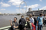 London - Great Britain / United Kingdom - 28 June 2008---London Eye, the big observation (Ferris) wheel, and tourists on Westminster Bridge over River Thames---tourism, architecture, people---Photo: Horst Wagner / eup-images